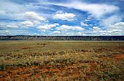 Open ranching prairie countryside with long fault scarp ridge, Mohave County, Arizona, USA
