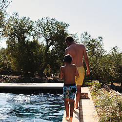Collette Dinnigan's husband Bradley and son Hunter going for a swim at their villa in Puglia. Ostuni, Italia. September 28, 2019.