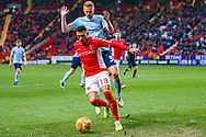 Charlton Athletic midfielder Karlan Ahearne-Grant (18) on the ball and holds off Accrington Stanley defender Liam Gibson (33) during the EFL Sky Bet League 1 match between Charlton Athletic and Accrington Stanley at The Valley, London, England on 19 January 2019.