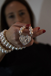 Christie's, London, April 10th 2017. A woman examines a 92 carat, D colour flawless heart shaped diamond, the largest ever to come to auction. It will be the main feature of Christie's Geneva jewels auction and is expected to fetch $14-20 million.   Credit: Paul Davey