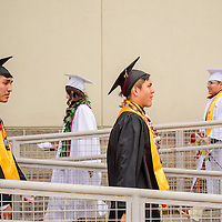 052315  Adron Gardner/Independent<br /> <br /> Tohatchi Cougar seniors file to the football field for graduation at Tohatchi High School Friday.