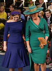Princess Beatrice of York and Sarah, Duchess of York take their seats ahead of the wedding of Princess Eugenie to Jack Brooksbank at St George's Chapel in Windsor Castle.