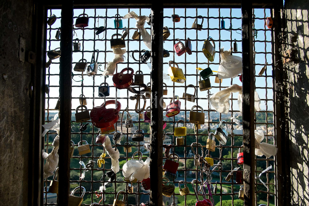 Locks on the railings, top of St Peters Basilica, Vatican, Rome, Italy.