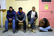 A group of refugees in Calais France are waiting to hear an outcome from a local residents meeting to see if they can have access to a public shower block..After the Sangatte refugee camp closed down an average of 200 refugees lived on the streets of Calais, without food, money or accommodation, trying most nights to get to Britain.  There were many different nationalities, mainly Iraqi and Afghani, but also Sudanese, Palestinian and Turkish. 95% are male, aged between 16 and 50.