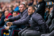 ( L-R ) caretaker Manager of Leicester City, Michael Appleton and his assistant Mike Sewell react in the dugout. Premier league match, Swansea city v Leicester city at the Liberty Stadium in Swansea, South Wales on Saturday 21st October 2017.<br /> pic by Aled Llywelyn, Andrew Orchard sports photography.