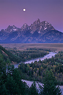 Moonset at dawn over the Teton Range and Snake River, Grand Teton Nat'l. Pk., WYOMING