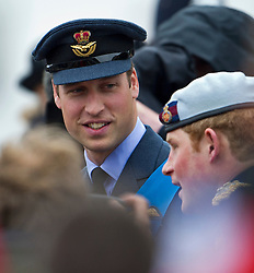 © Licensed to London News Pictures. 03/06/2012. London, UK.  Prince William talking to Prince Harry as they board the Royal Barge Spirit of Chartwell during the Jubilee Pageant on the River Thames, London on June 03,2012 as part of The Diamond Jubilee celebrations. Great Britain is celebrating the 60th  anniversary of the countries Monarch HRH Queen Elizabeth II accession to the throne . Photo credit : Ben Cawthra/LNP