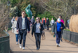 """© Licensed to London News Pictures. 24/02/2021. London, UK. Members of the public enjoy the sunshine and mild temperatures this afternoon in Hyde Park, London as weather forecasters predict a warm and sunny week ahead with highs of 17c in London today. This week, Prime Minister Boris Jonson announced his """"Roadmap Map' out of Lockdown with a gradual easing of Covid-19 restrictions with shops, pubs and gyms to open by April, Rule of Six and schools back by March and nightlife back by June. Photo credit: Alex Lentati/LNP"""