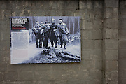 An outdoor exhibition panel showing a dead prisoner during the Todesmarsch (Death March) from Sachsenhausen concentration camp at the end of WW2, now known as the Sachsenhausen Memorial and Museum. Sachsenhausen was a Nazi and Soviet concentration camp in Oranienburg, 35 kilometres (22 miles) north of Berlin, Germany, used primarily for political prisoners from 1936 to the end of the Third Reich in May 1945. After World War II, when Oranienburg was in the Soviet Occupation Zone, the structure was used as an NKVD special camp until 1950. Executions took place at Sachsenhausen, especially of Soviet prisoners of war. 30,000 inmates died there from exhaustion, disease, malnutrition, pneumonia, etc. The remaining buildings and grounds are now open to the public as a museum.