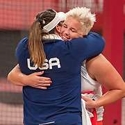 TOKYO, JAPAN August 3:    Gold medal winner Anita Wlodarczyk of Poland is congratulated after the Women's Hammer Throw Final at the Olympic Stadium during the Tokyo 2020 Summer Olympic Games on August 3rd, 2021 in Tokyo, Japan. (Photo by Tim Clayton/Corbis via Getty Images)