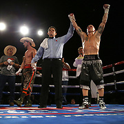 James Burns celebrates his victory over Ricky Tomlinson during a Fire Fist Boxing Promotions boxing match at the A La Carte Pavilion on Saturday, August 12 , 2017 in Tampa, Florida.  (Alex Menendez via AP)