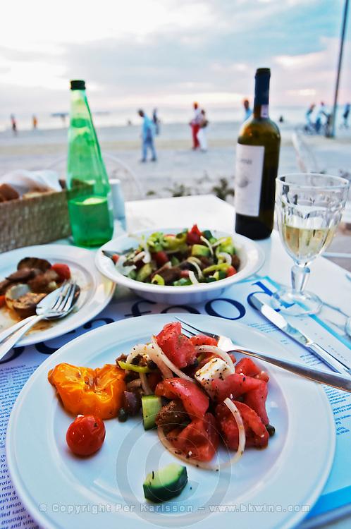 Dinner at a waterfront restaurant. Greek salad. Seafood restaurant at Macedonia Palace Hotel. Thessaloniki, Macedonia, Greece