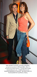 MISS HENRIETTA DUPS and HUGH HOWARD at a party in London on 20th July 2004.PXJ 111