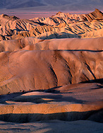 CADDV_011 - Eroded mudstone forms undulating hills, early morning view west from Zabriskie Point, National Park, California, USA