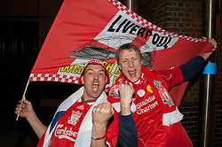 © licensed to London News Pictures. London, UK 26/02/2012. Liverpool FC fans celebrating outside Wembley Park Station after their team won the Carling Cup at Wembley Arena by defeating Cardiff City FC. Photo credit: Tolga Akmen/LNP