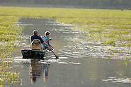 Town of Mamakating, N.Y. - A man paddles a row boat while a boy gets ready to cast his fishing rod on an spring evening in the Bashakill Wildlife Management Area on May 4, 2006.