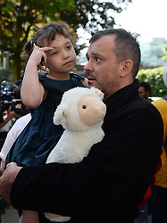 Resident Michael Paramasivan and his daughter Thea Kavanagh, 5, who managed to escape a fire that engulfed the 24-storey Grenfell Tower in west London.