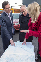 © Licensed to London News Pictures . 28/01/2013 . Manchester , UK . L-R George Osborne (the British Chancellor of the Exchequer and MP for Tatton ), Sir Richard Leese (Labour leader of Manchester City Council) and Amanda White (Senior Route Engineer HS2) , study a map of the proposed HS2 route in the car park at Manchester Piccadilly Train Station today (28th January 2013) as the government are due to reveal the proposed route for HS2 rail , linking Manchester , Leeds and Birmingham to London . Photo credit : Joel Goodman/LNP