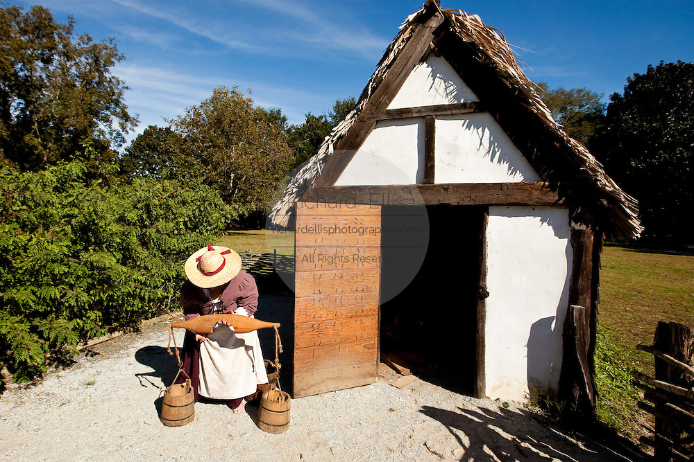 A re-enactor portraits a farm worker at historic Charles Towne Landing, the original settlement of Charleston, SC where English settlers established the city in 1670. The site is now a state park and historic site.