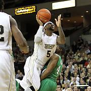 Central Florida guard Marcus Jordan (5) drives past Marshall guard Johnny Higgins (4) during a Conference USA NCAA basketball game between the Marshall Thundering Herd and the Central Florida Knights at the UCF Arena on January 5, 2011 in Orlando, Florida. Central Florida won the game 65-58 and extended their record to 14-0.  (AP Photo/Alex Menendez)