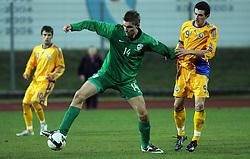 Jovan Vidovic (14)  of Slovenia vs Liuiu Ganea of Romania during Friendly match between U-21 National teams of Slovenia and Romania, on February 11, 2009, in Nova Gorica, Slovenia. (Photo by Vid Ponikvar / Sportida)