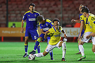 Brighton and Hove Albion defender Antef Tsoungui (71) is tackled by AFC Wimbledon midfielder Ayoub Assal (17)during the EFL Trophy Southern Group G match between AFC Wimbledon and Brighton and Hove Albion U21 at The People's Pension Stadium, Crawley, England on 22 September 2020.