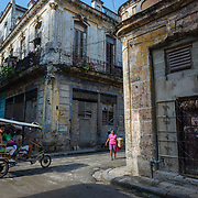 Bicycle taxi at the intersection of Habana Street in Havana