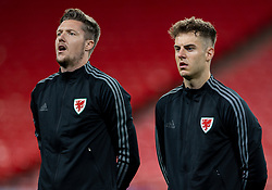 LONDON, ENGLAND - Thursday, October 8, 2020: Wales' goalkeeper Wayne Hennessey and Joe Rodon line-up for the national anthem before the International Friendly match between England and Wales at Wembley Stadium. The game was played behind closed doors due to the UK Government's social distancing laws prohibiting supporters from attending events inside stadiums as a result of the Coronavirus Pandemic. England won 3-0. (Pic by David Rawcliffe/Propaganda)