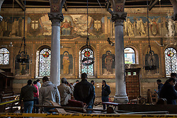 December 11, 2016 - Cairo, Egypt - Police and church officials survey the damage of an explosion inside the Coptic Cathedral in Cairo, Egypt, December 11, 2016. (Credit Image: © Sima Diab via ZUMA Wire)