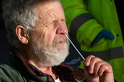 © Licensed to London News Pictures 07/01/2021. Bexleyheath, UK. A man having a Covid19 swab test. (Consent has been given) A Coronavirus self testing site has been set up on the Broadway in Bexleyheath, South East London. An estimated one in 30 people in London were infected with Covid-19 between December 27th and January the 2nd. Photo credit:Grant Falvey/LNP
