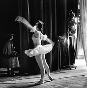 Ballerina warming up backstage at the San Francisco Opera House