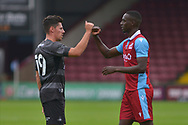 Abo Eisa (11) of Scunthorpe United touches fists with Trialist for Doncaster Rovers after the Pre-Season Friendly match between Scunthorpe United and Doncaster Rovers at Glanford Park, Scunthorpe, England on 15 August 2020.