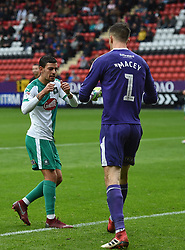 Plymouth Argyle's Gary Sawyer celebrates with keeper Matt Macey after he saves a penalty