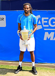 Dustin Brown of Germany poses after winning the AEGON Manchester Trophy  - Mandatory by-line: Matt McNulty/JMP - 05/06/2016 - TENNIS - Northern Tennis Club - Manchester, United Kingdom - AEGON Manchester Trophy