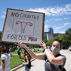 Several hundred Texans rally at the State Capitol in Austin protesting recently enacted legislation by Governor Greg Abbott that severely restrictions access to legal abortions. The law outlaws abortion procedures after detection of a heartbeat, generally six weeks after conception, or about the time a woman is aware of a preganacy.