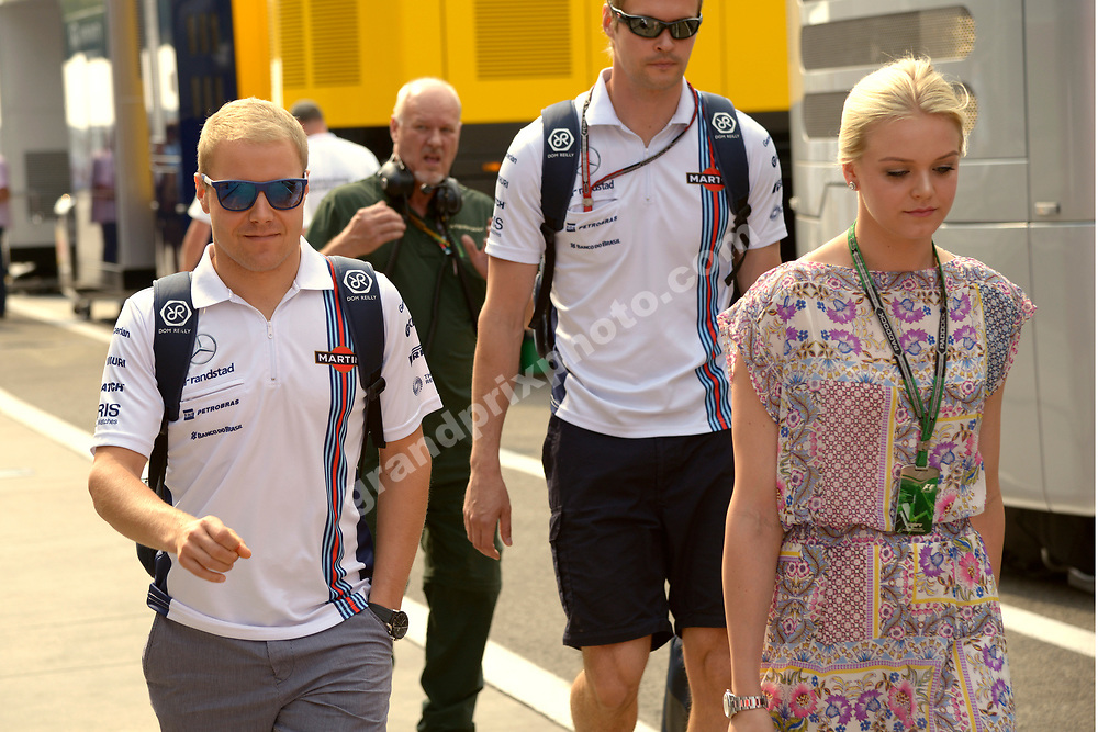 Valtteri Bottas (Williams-Renault) and girlfriend arrive for the 2014 Hungarian Grand Prix at the Hungaroring outside Budapest. Photo: Grand Prix Photo