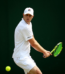 Sam Querrey in action on day three of the Wimbledon Championships at the All England Lawn Tennis and Croquet Club, Wimbledon.