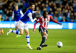 Sheffield Wednesday's David Jones and Brentford's Romaine Sawyers battle for the ball