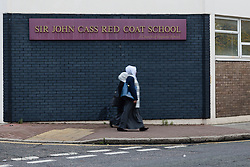 """© Licensed to London News Pictures. 20/11/2014. London, UK. A general view of the Sir John Cass Foundation and Redcoat Church of England Secondary school, in Stepney, east London. The school is expected to be placed in """"special measures"""" by the education standards watchdog, Ofstead for failing to monitor the activities of an Islamic society set up by sixth-formers at the school and has been criticised for the allowing segregation between boys and girls in the playground. Photo credit : Vickie Flores/LNP"""