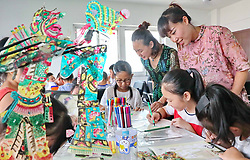 August 8, 2017 - Qinhuangdao, Qinhuangdao, China - Qinhuangdao, CHINA-August 8 2017: (EDITORIAL USE ONLY. CHINA OUT) ..Kids experience traditional Chinese culture of shadow play in Qinhuangdao, north China's Hebei Province, August 8th, 2017. (Credit Image: © SIPA Asia via ZUMA Wire)