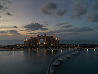 Aerial view of the luxurious Palm Jumeirah Atlantis Hotel and monorail at night in Dubai, United Arab Emirates.