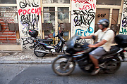 Graffiti on a wall in the area of Monastiraki. Visitors to Athens can't help but notice the amount of graffiti in the city. Any surface that can be sprayed upon is covered with a maddening number of signatures and designs. Beautifully restored neo-classic houses from the late 19th Century usually have a few days or weeks before they are covered in graffiti and owners find themselves in a war that they eventually lose and surrender to the kids. Graffiti in Athens is as old as the city itself. In ancient times graffiti was carved into buildings, in fact the word comes from the Greek graphi which means to write. The most disturbing aspect of the graffiti besides the volume of it, is the way some of the kids whose artistic ability begins and ends with their names (tags), have defaced some of the real works of art. Athens is the capital and largest city of Greece. It dominates the Attica periphery and is one of the world's oldest cities, as its recorded history spans around 3,400 years. Classical Athens was a powerful city-state. A centre for the arts, learning and philosophy.