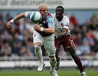 Photo: Lee Earle.<br /> West Ham United v Arsenal. The FA Barclays Premiership. 29/09/2007. West Ham's Dean Ashton (L) chases the ball, watched by Arsenal's Kolo Toure.