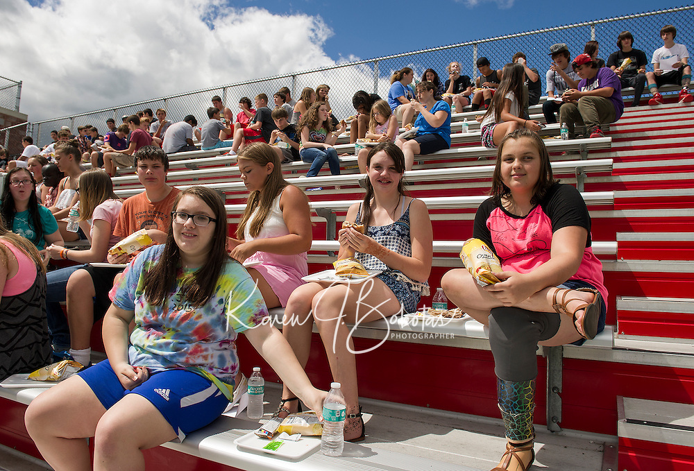 Laconia High School incoming freshmen Aimie Paige, Michael Von George, Jillian MacDonald, Zoe Glines and Makenzie Hartman enjoy a bbq lunch during their two hour orientation on Thursday morning.  (Karen Bobotas/for the Laconia Daily Sun)