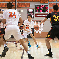 Gallup's Quinn Atazhoon (24) drives to the basket against Espanola Valley Thursday night in Gallup.