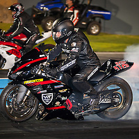 Rob Wasley (4726) burning out with Stan Lisle (2790) in the background - Modified Bike.