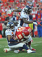 KANSAS CITY, MO - DECEMBER 01:  Defenders Champ Bailey #24 and Duke Ihenacho #33 of the Denver Broncos tackle tight end Anthony Fasano #80 of the Kansas City Chiefs during the first half on December 1, 2013 at Arrowhead Stadium in Kansas City, Missouri.  (Photo by Peter G. Aiken/Getty Images) *** Local Caption *** Champ Bailey;Duke Ihenacho;Anthony Fasano