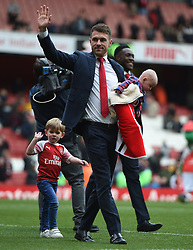 Arsenal's Aaron Ramsey waves good bye to the home fans at full time