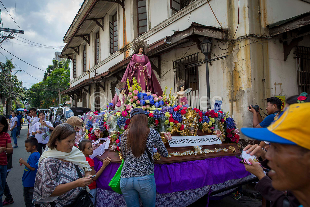 A float in honour of 'Our Lady, The Untier of Knots' for the Grand Marian Parade in Intramuros, Metro Manila, Philippines. (photo by Andrew Aitchison/In Pictures via Getty Images)