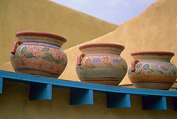 North America, United States, New Mexico, Taos, clay urns on roof of adobe house